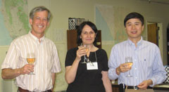 Director Brian Conrey celebrates with 100th Workshop Organizers Maria-Carme Calderer and Jie Shen.